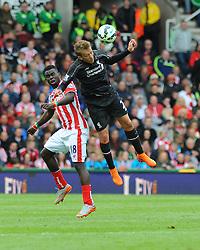 Stoke City's Mame Biram Diouf and Liverpool's Lucas Leiva battle for the high ball - Photo mandatory by-line: Nizaam Jones/JMP - Mobile: 07966 386802 - 24/05/2015 - SPORT - Football - Stoke - Britannia Stadium - Stoke City v Liverpool - Barclays Premier League