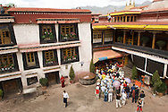 A tour group prepares to enter the Jokhang Monastery in Lhasa, Tibet.