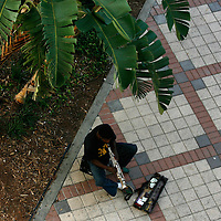 ST. PETERSBURG, FL -- June 29, 2008 -- Music is played for tips along the walkway for pedestrians as they make their way to and from the outdoor BayWalk entertainment complex in downtown St. Petersburg, Fla., on Sunday, June 29, 2008.  St. Petersburg's downtown is thriving with new shops, restaurants, and bars that are feeding off a younger, energetic crowd that fills its walkable map pinpointed with rejuvenated historic hotels and condos.