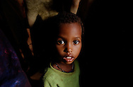 El Barde, Somalia.  A boy waits to see a doctor in a health clinic run by the World Food Programme in El Barde, Somalia.  This region of northern Somalia, close to the ethiopian border has been suffering a severe drought for years.  (PHOTO: MIGUEL JUAREZ LUGO)