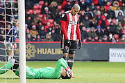 Leon Clarke of Sheffield United (9) shows concern for Castel Pantilimon of Nottingham Forest (1) during the EFL Sky Bet Championship match between Sheffield United and Nottingham Forest at Bramall Lane, Sheffield, England on 17 March 2018. Picture by Mick Haynes.