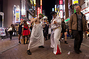Western men dressed at a Roman Emperor and Elvis enjoy the Halloween celebrations in Shibuya. Saturday October 28th 2017