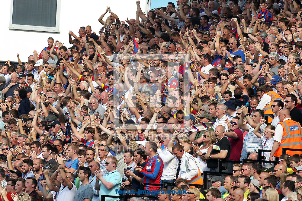 The traveling Crystal Palace fans celebrate their side's opening goal during the Barclays Premier League match at Carrow Road, Norwich<br /> Picture by Paul Chesterton/Focus Images Ltd +44 7904 640267<br /> 08/08/2015