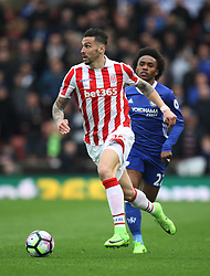 Geoff Cameron of Stoke City (L) and Willian of Chelsea in action - Mandatory by-line: Jack Phillips/JMP - 18/03/2017 - FOOTBALL - Bet365 Stadium - Stoke-on-Trent, England - Stoke City v Chelsea - Premier League