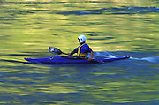 THIS PHOTO IS AVAILABLE FOR WEB DOWNLOAD ONLY. PLEASE CONTACT US FOR A LARGER PHOTO. Idaho. Kayaker with fall colors reflecting in the water.
