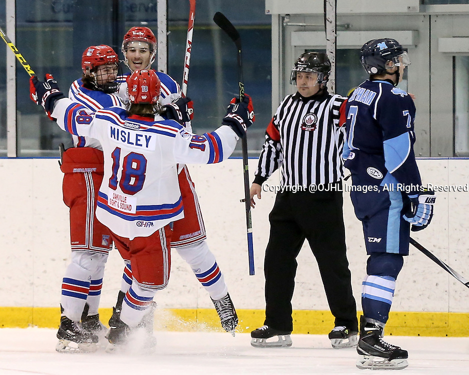 Oakville, ON - MAR 4, 2016  Ontario Junior Hockey League game action between St. Michael's and Oakville Blades at the Sixteen Mile Sports Complex Oakville, ON. Ryan Foss #12 of the Oakville Blades scores during the second period and celebrates with teammates. <br /> (Photo by Kevin Sousa / OJHL Images)