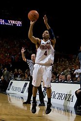Virginia guard Calvin Baker (4) shoots a three pointer against Virginia Tech.  The Virginia Cavaliers men's basketball team fell to the Virginia Tech Hokies 70-69 in overtime at the John Paul Jones Arena in Charlottesville, VA on January 16, 2008.