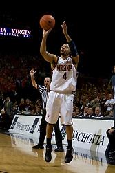 Virginia guard Calvin Baker (4) shoots a three pointer against Virginia Tech.  The Virginia Cavaliers men's basketball team fell to the Virginia Tech Hokies 70-69 in overtime at the John Paul Jones Arena in Charlottesville, VA on January 16, 2008.