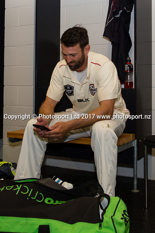 Andrew Ellis of Canterbury  watches the result of the CD v Auk match during Day4 of the Plunket Shield cricket game, Canterbury V Wellington, Hagley Oval, Christchurch, New Zealand, 1st April 2017.Copyright photo: John Davidson / www.photosport.nz