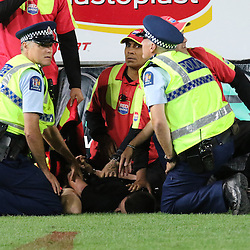 Police wrap a streker during the Investec Super  Rugby match between the Chiefs and Blues at FMG Waikato Stadium in Hamilton, New Zealand on Friday 3 March 2017. Photo: Dion Mellow / lintottphoto.co.nz