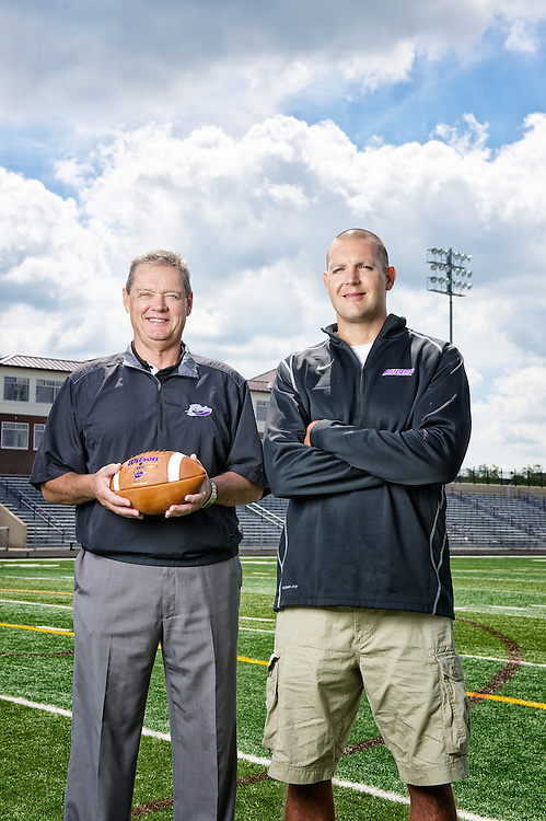 Vince, left, and Larry Kehres on the Mount Union football field on July 30, 2013.