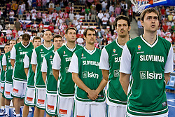 Slovenian team (from R Erazem Lorbek (15) of Slovenia, Jurica Golemac (14) of Slovenia, Domen Lorbek (13) of Slovenia, Goran Jagodnik (12) of Slovenia, Goran Dragic (11) of Slovenia, Bostjan Nachbar (10) of Slovenia and Jaka Klobucar (9) of Slovenia) listening to the national anthem  during the EuroBasket 2009 Group F match between Slovenia and Poland, on September 14, 2009 in Arena Lodz, Hala Sportowa, Lodz, Poland.  (Photo by Vid Ponikvar / Sportida)