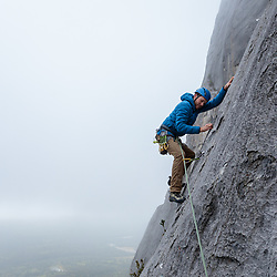 Mark Howell climbing the second pitch of Cheese Grater, 5.8 at Guide's Rock in Banff, National Park
