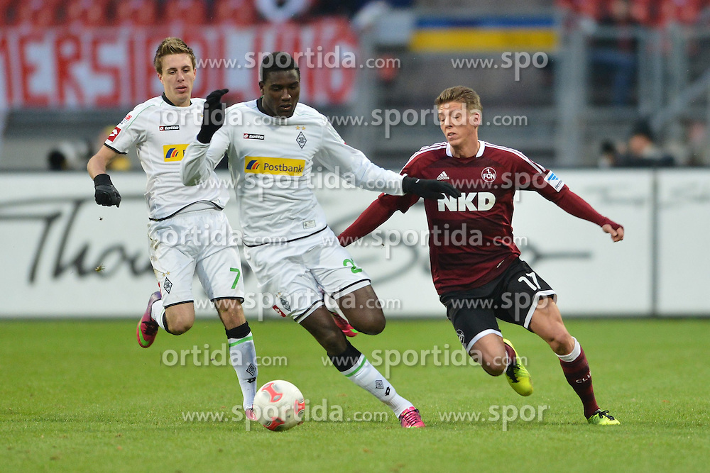 03.02.2013, easyCredit Stadion, Nuernberg, GER, 1. FBL, 1. FC Nuernberg vs Borussia Moenchengladbach, 20. Runde, im Bild Peniel MLAPA (Borussia Moenchengladbach/ Mitte) im Zweikampf mit Mike FRANTZ (1.FC Nuernberg/ rechts). Hinten links: Patrick HERRMANN (Borussia Moenchengladbach). Action / Aktion // during the German Bundesliga 20th round match between 1. FC Nuernberg and Borussia Moenchengladbach at the easyCredit Stadium, Nuernberg, Germany on 2013/02/03. EXPA Pictures © 2013, PhotoCredit: EXPA/ Eibner/ Matthias Merz..***** ATTENTION - OUT OF GER *****