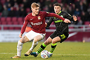 Northampton Town midfielder Ryan Watson (8) battles for possession  with Forest Green Rovers forward (on loan from Celtic) Jack Aitchison (29) during the EFL Sky Bet League 2 match between Northampton Town and Forest Green Rovers at the PTS Academy Stadium, Northampton, England on 14 December 2019.