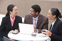 Three business people having meeting