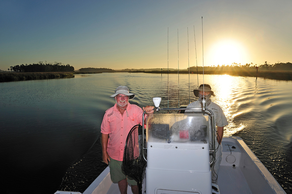 Captain Frank Bourgeois and Steven Soults on his boat, Angling Adventures, exploring the Gulf of Mexico, near Spring Hill, Florida