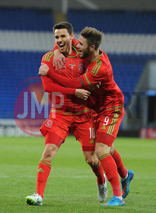 Tom O'Sullivan of Wales u21s (Cardiff City) celebrates his goal with Wes Burns of Wales u21s (Bristol City) - Photo mandatory by-line: Dougie Allward/JMP - Mobile: 07966 386802 - 31/03/2015 - SPORT - Football - Cardiff - Cardiff City Stadium - Wales v Bulgaria - U21s International Friendly