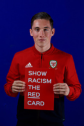CARDIFF, WALES - Tuesday, October 9, 2018: Wales' Harry Wilson holds a Show Racism The Red Card sign during a media session at the St Fagans National Museum of History ahead of the International Friendly match between Wales and Spain. (Pic by David Rawcliffe/Propaganda)