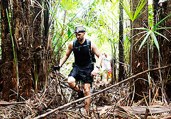 "© Licensed to London News Pictures. 11/10/2013. BRAZIL. Athletes running through dense amazon jungle. Competitors take part in the Jungle Marathon 2013, the ""The toughest ultra marathon in the world"" The race is 245 km long through the biggest jungle in the world, The Amazon. It attracts competitors from all countries world wide. Competitors run through territories of indigenous tribes throughout the 7 day race, where they stay with them as guests.. Photo credit : Alexander Beer/LNP"