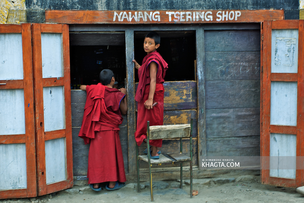 Young Monks standing outside Nawang Tsering Shop in village Thiskey, Ladakh.
