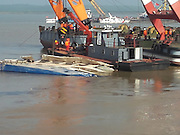 JIANLI, CHINA - JUNE 05: (CHINA OUT) <br /> <br /> Rescue Continues After Ship Sinking In Yangtze<br /> <br /> Rescuers raise the sunk ship early morning on June 5, 2015 in Jianli County in Jingzhou, Hubei province of China. A passenger ship named Dongfangzhixing (Eastern Star) carrying 458 people, including 406 Chinese passengers, 5 travel agency workers and 47 crew members aboard, according to the administration, sank at around 9:28 p.m. on Monday in the Jianli (Hubei Province) section of the Yangtze River. Fourteen people have been rescued and 82 are confirmed dead and further rescue work continues in the accident site.<br /> ©Exclusivepix Media