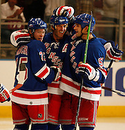 Brendan Shanahan (C)  of the New York Rangers celebrates after scoring his 600th career goal  with (L) Petr Prucha and (R) Fedor Tyutin against the Washington Capitals  at Madison Square Garden in New York Thursday 05 October 2006.<br />