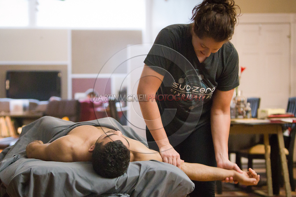 "ST. LOUIS, MO, JUNE 16, 2015: Patricio ""Pitbull"" Freire enjoys a massage by therapist Megan Sanders a few days ahead of his fight at Bellator 138 in St. Louis, Missouri © Sara Levin"