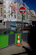 Street roadworks barriers and retail shop hoarding in Rue de Rivoli, Paris.