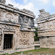 "Ornately decorated buildings at Chichen Itza, a pre-Columbian archeological site in Yucatan, Mexico. This building is known as ""La Iglesia"" and is in the Las Monjas complex of buildings."