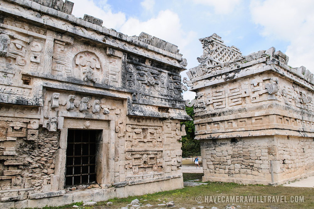 """Ornately decorated buildings at Chichen Itza, a pre-Columbian archeological site in Yucatan, Mexico. This building is known as """"La Iglesia"""" and is in the Las Monjas complex of buildings."""