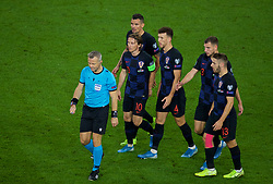 CARDIFF, WALES - Sunday, October 13, 2019: Croatia players, led by captain Luka Modrić, cause referee Björn Kuipers after Wales' equalising goal during the UEFA Euro 2020 Qualifying Group E match between Wales and Croatia at the Cardiff City Stadium. (Pic by Paul Greenwood/Propaganda)