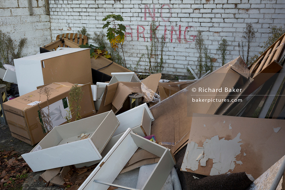 Fly-tipped boxes, furniture and domestic possessions dumped on a single parking space in East Dulwich, in south London, England, on 4th December 2019.
