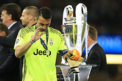 3rd June 2017 - UEFA Champions League Final - Juventus v Real Madrid - Juventus goalkeeper Gianluigi Buffon walks past the trophy - Photo: Simon Stacpoole / Offside.