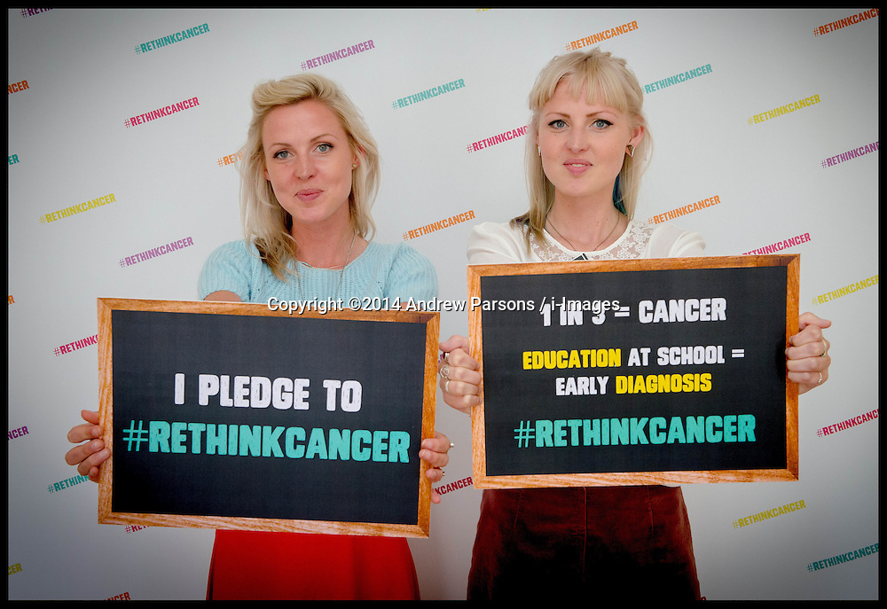 Image ©Licensed to i-Images Picture Agency. 25/06/2014. London, United Kingdom. Coppafeel founder Kris Hallenga (Right)  launches her RethinkCancer Manifesto in the House of Commons with her twin sister Maren . Picture by Andrew Parsons / i-Images