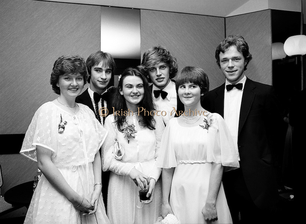 Fresh faces at the eighteenth annual Notres Dames des Missions Debutantes Ball, at Jury's Hotel, Dublin. (l–r:) Miss Emer Fannin, Templeogue, Dublin, with Ted O'Sullivan; Miss Fiona Daly, Ardilea, Dublin, with Ronan Hannigan; and Miss Maria Gahan, Stepaside, County Dublin, with Philip O'Connor.<br /> 15 November 1980