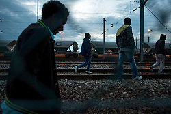 **Images taken on the evening of the 11th of August** © London News Pictures. 11/08/2015. Calais, France. A group of migrants make their way along the Eurotunnel tracks away from the main terminal after being confronted by police.  Photo credit: Ben Cawthra/LNP