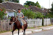 Boy riding horse in Manuel Lazo,  Pinar del Rio, Cuba.