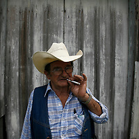 NEWBERRY, FL -- August 23, 2009 -- Larry Ford smokes a cigarette as he stands for a portrait in downtown Newberry, Fla., on Sunday, August 23, 2009.  The self-described cowboy lives on seven acres in rural Florida with a horse, 4 dogs, and a handful of cats on his property after his wife died three years ago.  He took out a reverse mortgage on his home, but in July, the owner of the Orlando, Fla., title company that handled Mr. Fordâ??s loan admitted to stealing more than $1 million from several reverse mortgages, including Mr. Fordâ??s. Bank of America Corp., which says the title agent never sent it the money required to pay off Mr. Fordâ??s mortgage, is now threatening to foreclose on his ranch.  .(CREDIT:  Chip Litherland for the Wall Street Journal)..REVERSE