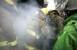 Afghan fire fighters try to extinguish fire from burning market in Kabul, Afghanistan , December 23, 2012. Photo by Imago / i-Images...UK ONLY