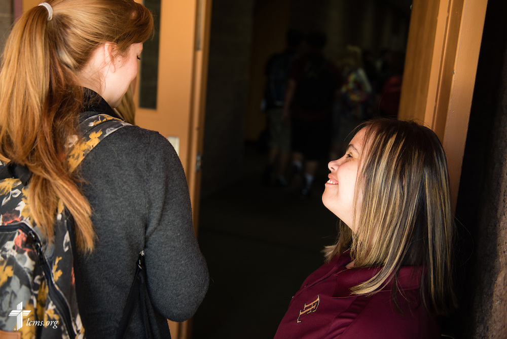 Mark 10:14 Program student Madison Hinskey holds the door for fellow students heading to class at Faith Lutheran Middle School & High School on Tuesday, May 26, 2015, in Las Vegas, Nev.  LCMS Communications/Erik M. Lunsford