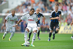 SWANSEA, WALES - Sunday, October 2, 2011: Swansea City's Scott Sinclair scores the first goal against Stoke City from the penalty spot during the Premiership match at the Liberty Stadium. (Pic by David Rawcliffe/Propaganda)