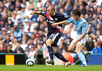 Photo: Daniel Hambury.<br /> Manchester City v West Bromich Albion. Barclaycard Premiership. 13/08/2005.<br /> Manchester City's Joey Barton is held off by West Brom's Ronnie Wallwork.