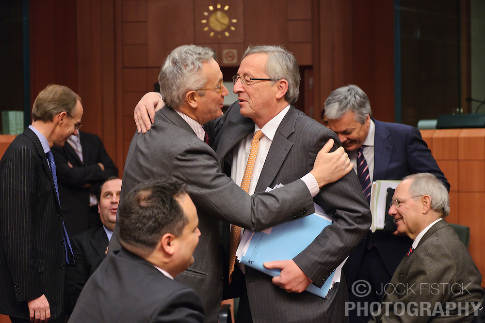 Jean-Claude Juncker, Luxembourg's prime minister, and president of the Eurogroup, center, greets Giulio Tremonti, Italy's finance minister, during the Eurogroup meeting in Brussels, Monday Dec. 6, 2010. (Photo © Jock Fistick)