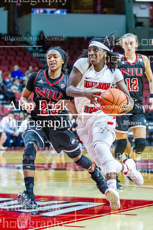 NORMAL, IL - November 20: Tete Maggett works hard to get into the paint while defended by Myia Starks during a college women's basketball game between the ISU Redbirds and the Huskies of Northern Illinois November 20 2019 at Redbird Arena in Normal, IL. (Photo by Alan Look)