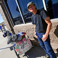 022813  Adron Gardner/Independent<br /> <br /> Flynn Donoho poses for a portrait outside Wal-Mart in Gallup Friday.  Donoho and his dog Diva are crossing the USA on a bicycle for Cancer.