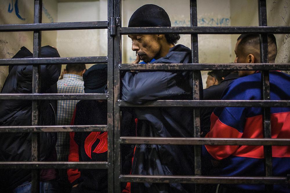 A group of men were detained in the streets with drugs and arrested in a local police station in Tijuana, Mexico. SPANISH: Varios hombres son detenidos en una celda de la policía local por supuesta posesión de drogas en las calles de Tijuana, México. 09 de marzo de 2009.