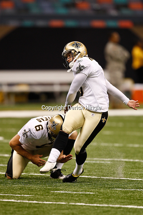 August 27, 2010; New Orleans, LA, USA; New Orleans Saints place kicker Garrett Hartley (5) kicks during warm ups  prior to the start of a preseason game at the Louisiana Superdome. The New Orleans Saints defeated the San Diego Chargers 36-21. Mandatory Credit: Derick E. Hingle