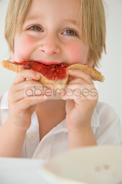Boy Eating Jam on Toast