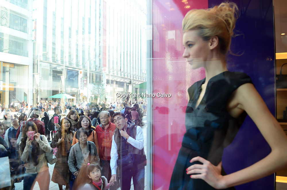 Real model act as mannequins at Furla store, Ginza street, Tokyo